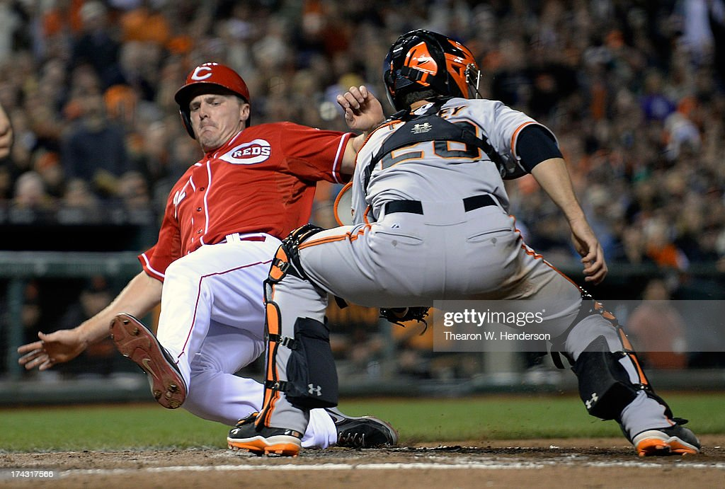 <a gi-track='captionPersonalityLinkClicked' href=/galleries/search?phrase=Jay+Bruce&family=editorial&specificpeople=4391540 ng-click='$event.stopPropagation()'>Jay Bruce</a> #32 of the Cincinnati Reds scores on an RBI triple from Todd Frazier #21, beating the tag of <a gi-track='captionPersonalityLinkClicked' href=/galleries/search?phrase=Buster+Posey&family=editorial&specificpeople=4896435 ng-click='$event.stopPropagation()'>Buster Posey</a> #28 of the San Francisco Giants in the fifth inning at AT&T Park on July 23, 2013 in San Francisco, California.