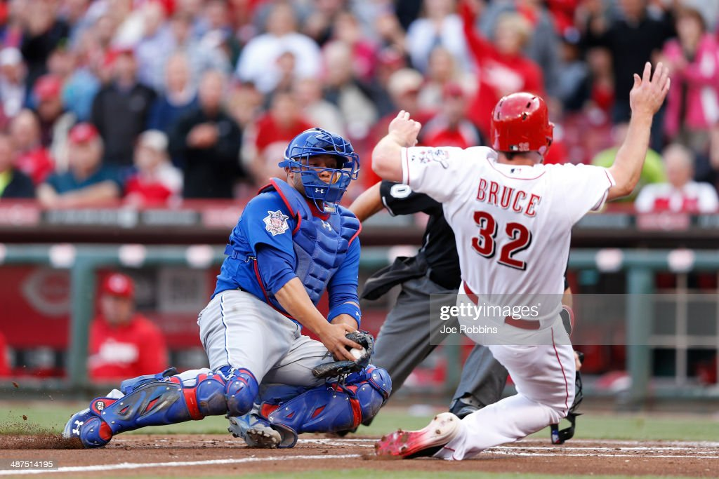 <a gi-track='captionPersonalityLinkClicked' href=/galleries/search?phrase=Jay+Bruce&family=editorial&specificpeople=4391540 ng-click='$event.stopPropagation()'>Jay Bruce</a> #32 of the Cincinnati Reds slides at home plate ahead of the tag by <a gi-track='captionPersonalityLinkClicked' href=/galleries/search?phrase=Welington+Castillo&family=editorial&specificpeople=4959193 ng-click='$event.stopPropagation()'>Welington Castillo</a> #5 of the Chicago Cubs in the first inning of the game at Great American Ball Park on April 30, 2014 in Cincinnati, Ohio.