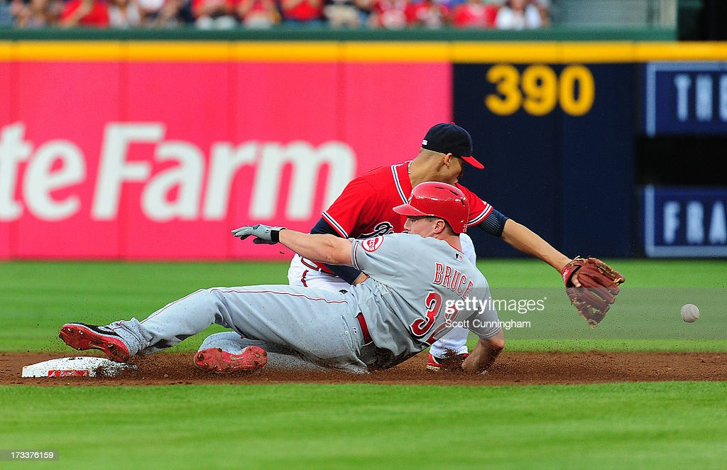 <a gi-track='captionPersonalityLinkClicked' href=/galleries/search?phrase=Jay+Bruce&family=editorial&specificpeople=4391540 ng-click='$event.stopPropagation()'>Jay Bruce</a> #32 of the Cincinnati Reds slides in to second base for a double against <a gi-track='captionPersonalityLinkClicked' href=/galleries/search?phrase=Andrelton+Simmons&family=editorial&specificpeople=8978424 ng-click='$event.stopPropagation()'>Andrelton Simmons</a> #19 of the Atlanta Braves at Turner Field on July 12, 2013 in Atlanta, Georgia.