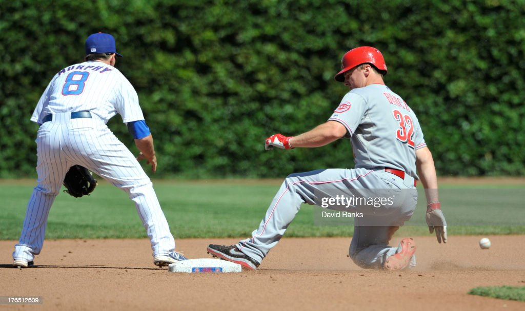 <a gi-track='captionPersonalityLinkClicked' href=/galleries/search?phrase=Jay+Bruce&family=editorial&specificpeople=4391540 ng-click='$event.stopPropagation()'>Jay Bruce</a> #32 of the Cincinnati Reds slides safely into second base with a double as Donnie Murphy #8 of the Chicago Cubs takes the throw during the seventh inning on August 14, 2013 at Wrigley Field in Chicago, Illinois.