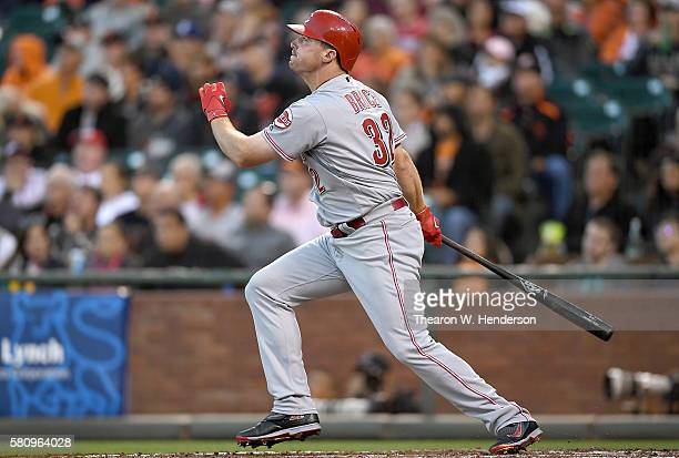 Jay Bruce of the Cincinnati Reds swings and watches the flight of his ball as he hits a tworun homer against the San Francisco Giants in the top of...