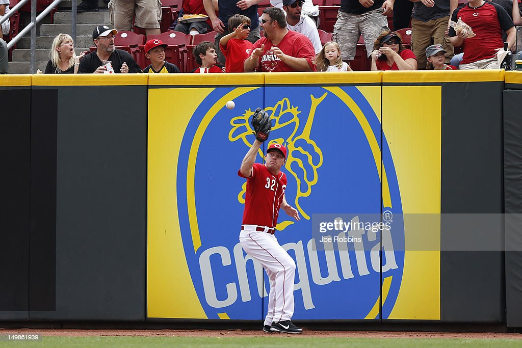 <a gi-track='captionPersonalityLinkClicked' href=/galleries/search?phrase=Jay+Bruce&family=editorial&specificpeople=4391540 ng-click='$event.stopPropagation()'>Jay Bruce</a> #32 of the Cincinnati Reds tries to play the ball off the outfield wall after a hit by Starling Marte #6 of the Pittsburgh Pirates that drove in two runs in the fourth inning of the game at Great American Ball Park on August 5, 2012 in Cincinnati, Ohio. The Pirates won 6-2.