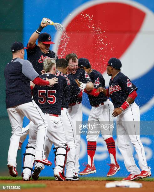 Jay Bruce of the Cleveland Indians celebrates with teammates after hitting a game winning single off Brandon Maurer of the Kansas City Royals during...