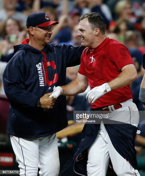 Jay Bruce of the Cleveland Indians gets congratulations from manager Terry Francona after hitting a game winning single off Brandon Maurer of the...