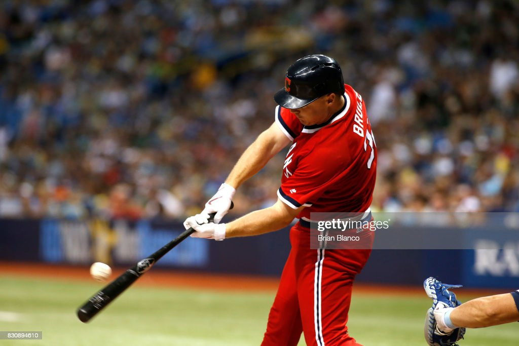 Jay Bruce #32 of the Cleveland Indians hits an RBI single off of pitcher Chris Archer of the Tampa Bay Rays to score Jose Ramirez during the sixth inning of a game on August 12, 2017 at Tropicana Field in St. Petersburg, Florida.