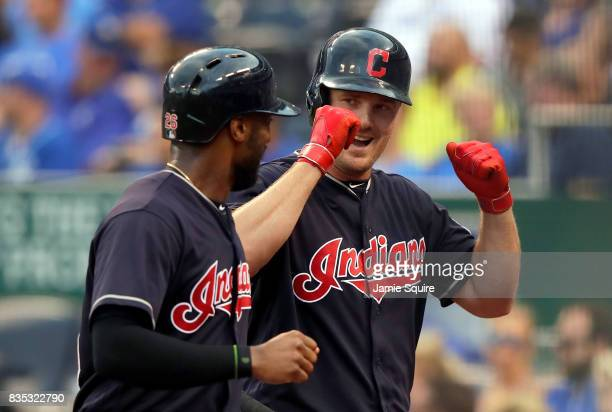 Jay Bruce of the Cleveland Indians is congratulated by Austin Jackson after hitting a 2run home run during the 1st inning of the game against the...