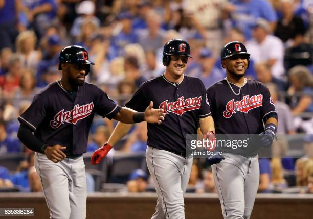 Jay Bruce of the Cleveland Indians is congratulated by Austin Jackson and Edwin Encarnacion after hitting a 3run home run during the 7th inning of...