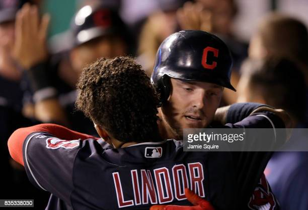 Jay Bruce of the Cleveland Indians is congratulated by Francisco Lindor in the dugout after hitting a 3run home run during the 7th inning of the game...
