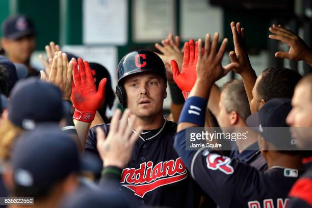 Jay Bruce of the Cleveland Indians is congratulated by teammates in the dugout after hitting a home run during the 1st inning of the game against the...