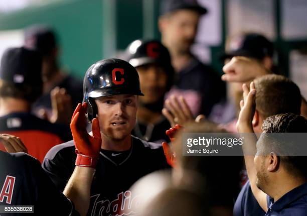 Jay Bruce of the Cleveland Indians is congratulated by teammates in the dugout after hitting a 3run home run during the 7th inning of the game...