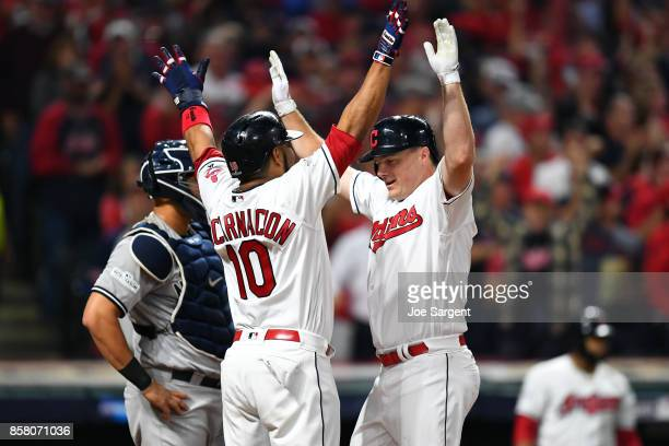 Jay Bruce of the Cleveland Indians is greeted by teammate Edwin Encarnacion after hitting a tworun home run during Game 1 of the American League...
