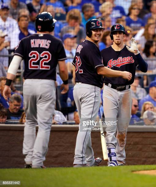 Jay Bruce of the Cleveland Indians looks back toward Jason Kipnis of the Cleveland Indians as they both scored on a Yan Gomes single during the 3rd...