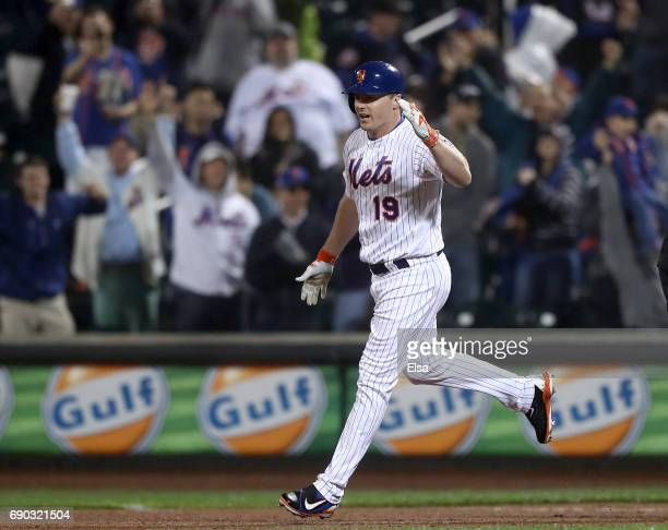 Jay Bruce of the New York Mets celebrates after he drives in the game winning run in the 12th inning against the Milwaukee Brewers on May 30 2017 at...
