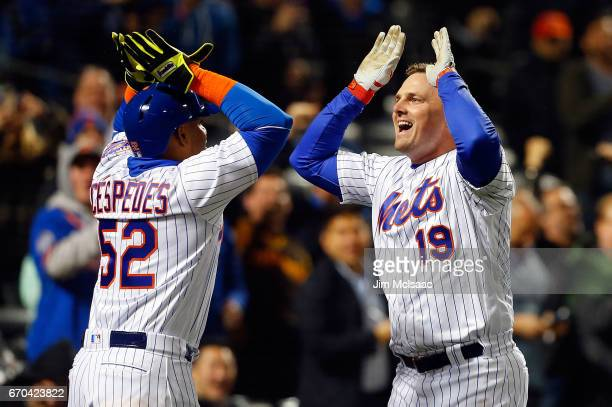 Jay Bruce of the New York Mets celebrates his sixth inning three run home run against the Philadelphia Phillies with teammate Yoenis Cespedes at Citi...