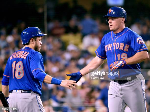 Jay Bruce of the New York Mets celebrates his solo homerun with Travis d'Arnaud to trail 72 to the Los Angeles Dodgers during the fourth inning at...