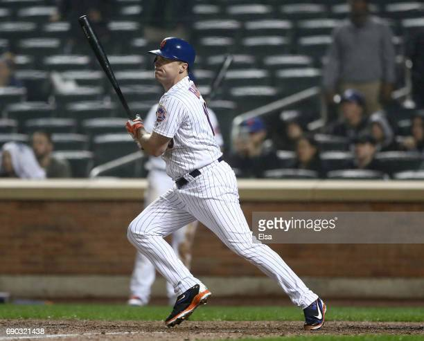 Jay Bruce of the New York Mets drives in the game winning run in the 12th inning against the Milwaukee Brewers on May 30 2017 at Citi Field in the...