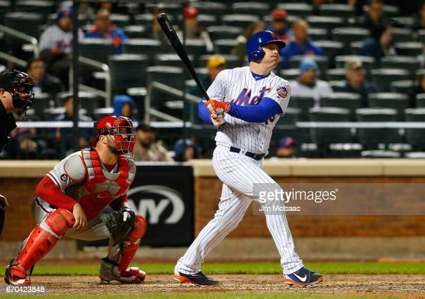 Jay Bruce of the New York Mets follows through on his sixth inning three run home run against the Philadelphia Phillies at Citi Field on April 19...
