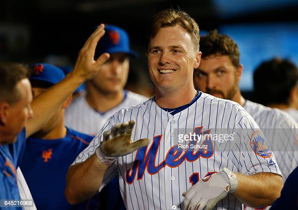 Jay Bruce of the New York Mets is congratulated by teammates after he hit a home run in the sixth inning of a game against the Miami Marlins at Citi...