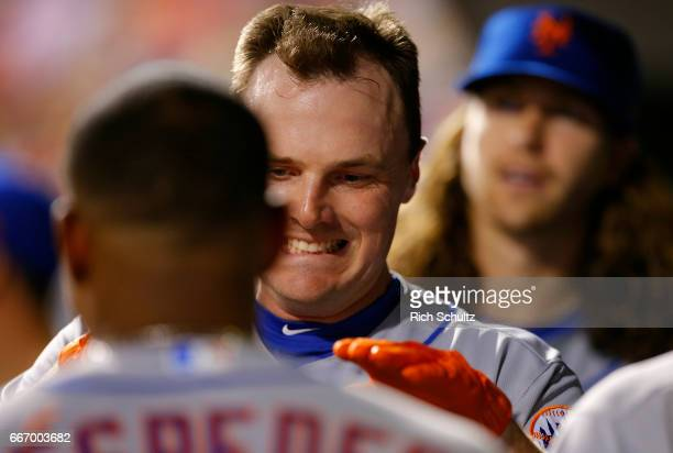 Jay Bruce of the New York Mets is congratulated by Yoenis Cespedes after he hit a home run during the fourth inning of a game against the...