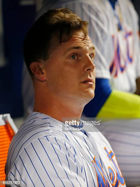 Jay Bruce of the New York Mets sits in the dugout after he hit a home run in the sixth inning of a game against the Miami Marlins at Citi Field on...