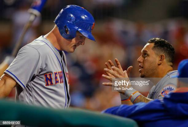 Jay Bruce of the New York Mets will get his helmet removed by Asdrubal Cabrera after hitting a home run during a game against the Philadelphia...