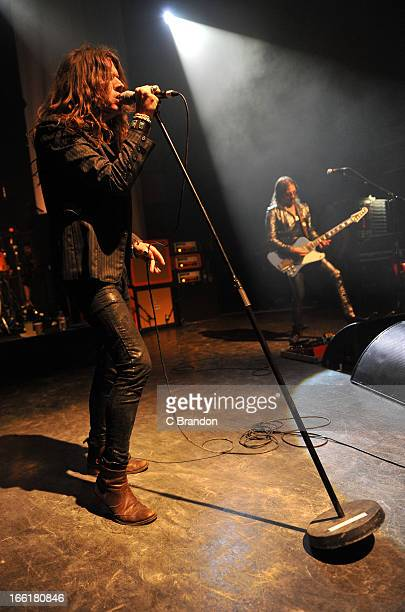 Jay Buchanan and Scott Holiday of Rival Sons perform on stage at O2 Shepherd's Bush Empire on April 9 2013 in London England