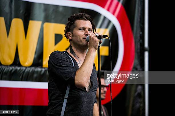 Jay Buchanan of Rival Sons performs in concert at Motor City Guitars on June 21 2014 in Waterford Michigan