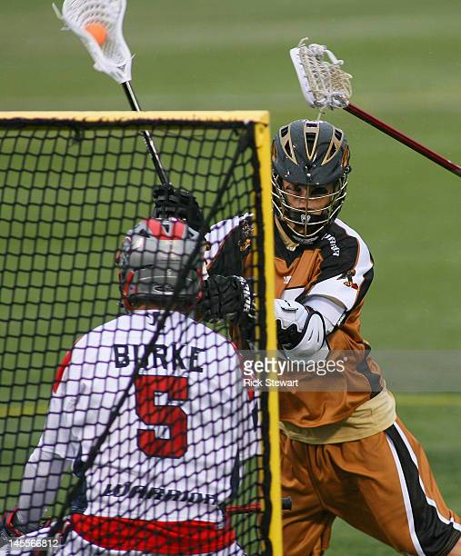 Jay Card of the Rochester Rattlers moves in on goal against Jordan Burke of the Boston Cannons at Sahlen's Stadium on June 1 2012 in Rochester New...