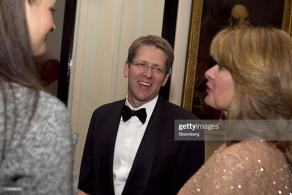 Jay Carney, White House press secretary, center, attends the Bloomberg Vanity Fair White House Correspondents' Association (WHCA) dinner afterparty in Washington, D.C., U.S., on Saturday, April 30, 2011. The dinner raises money for WHCA scholarships and honors the recipients of the organization's journalism awards. Photographer: Andrew Harrer/Bloomberg via Getty Images