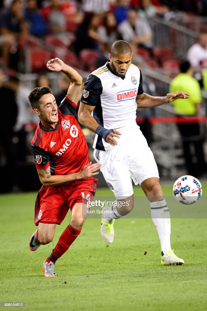 Jay Chapman (14) of Toronto FC and Oguchi Onyewu (5) of Philadelphia Union battle for the ball during the second half of the MLS Soccer regular season game between Toronto FC and Philadelphia Union on August 23, 2017, at BMO Field in Toronto, ON, Canada.