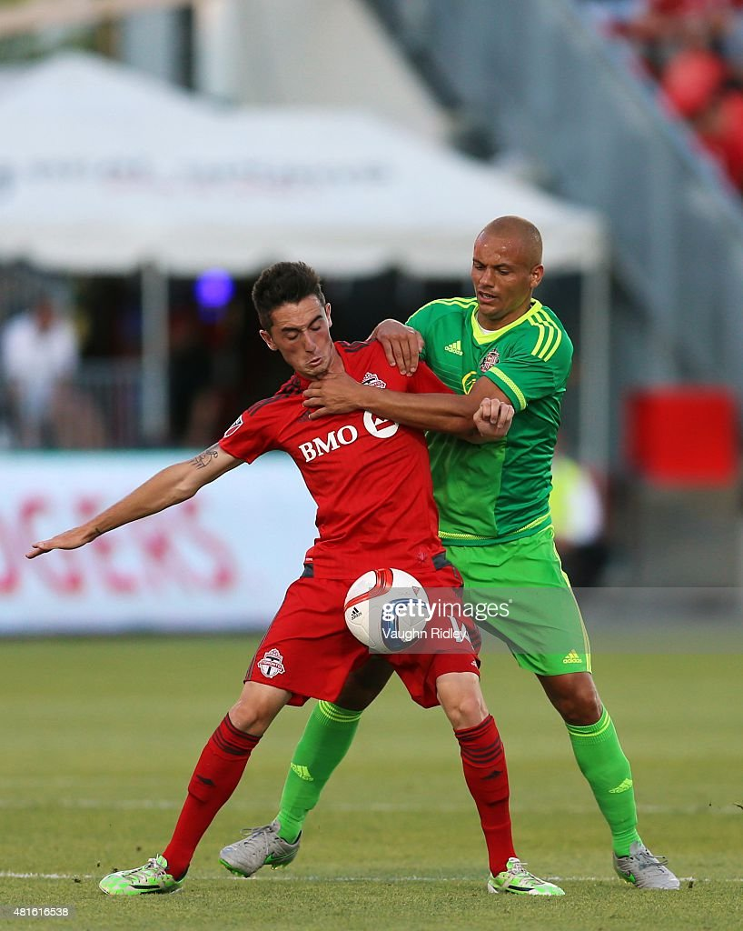 Jay Chapman #14 of Toronto FC and Wes Brown #5 of Sunderland AFC battle for the ball during a friendly match at BMO Field on July 22, 2015 in Toronto, Ontario, Canada.