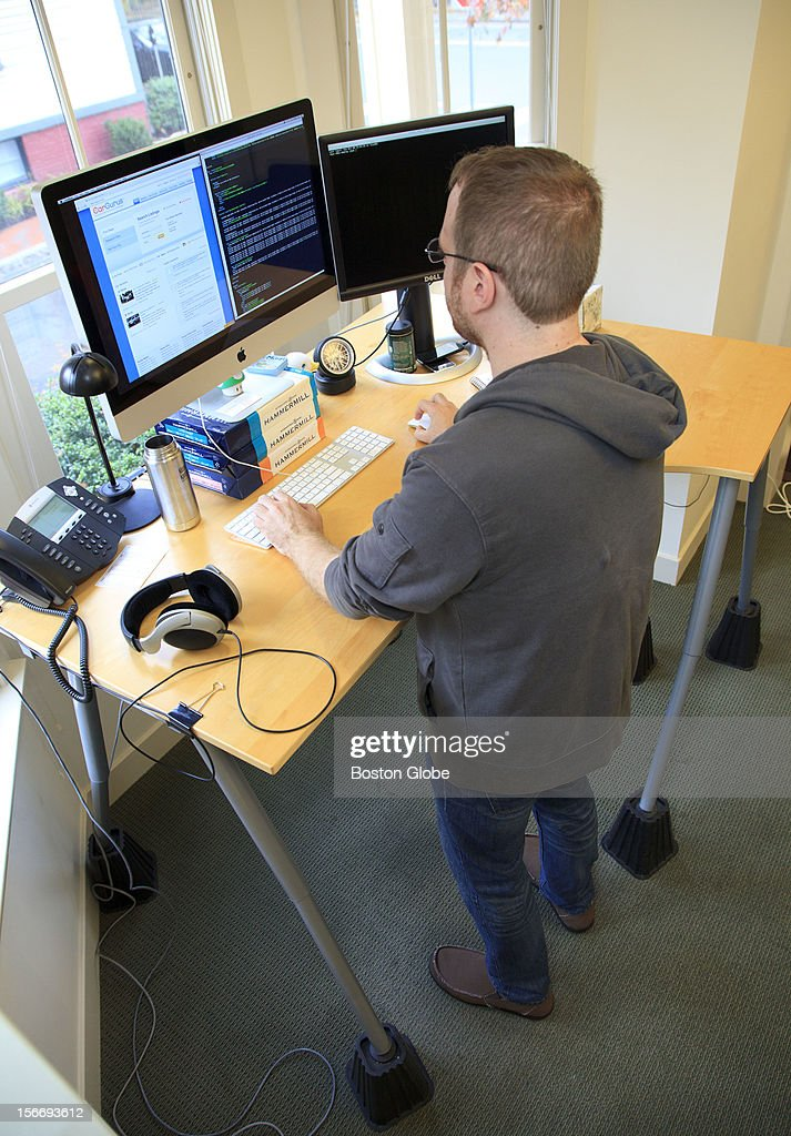 Jay Ciruolo, who works at Car Gurus, works at a stand up desk.