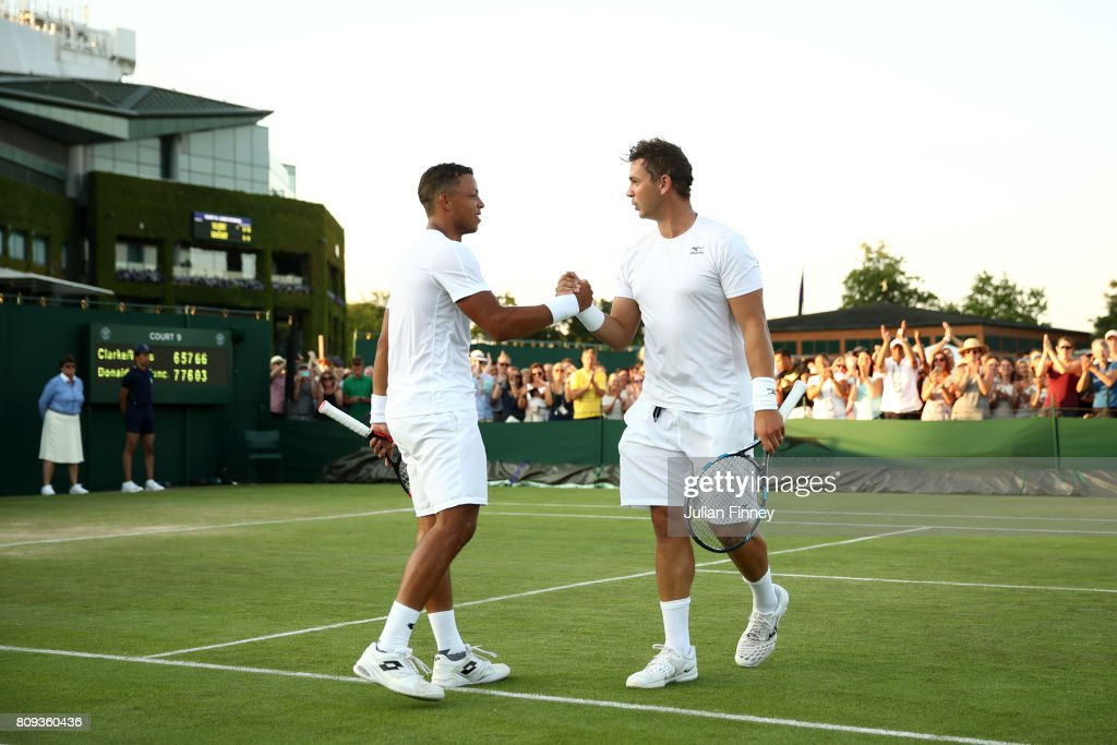 Jay Clarke of Great Britain and Marcus Willis of Great Britain celebrate victory after the Gentlemen's Doubles first round match against Jared Donaldson of the United States and Jeevan Nedunchezhiyan of India on day three of the Wimbledon Lawn Tennis Championships at the All England Lawn Tennis and Croquet Club on July 5, 2017 in London, England.