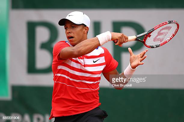 Jay Clarke of Great Britain hits a forehand during the Boys Singles first round match against Yibing Wu of China on day eight of the 2016 French Open...