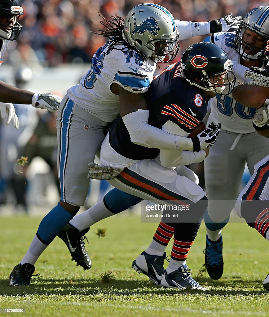 Jay Culer #6 of the Chicago Bears is sacked by Willie Young #79 of the Detroit Lions at Soldier Field on November 10, 2013 in Chicago, Illinois.