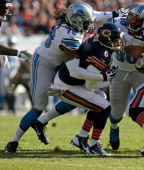 Jay Culer of the Chicago Bears is sacked by Willie Young of the Detroit Lions at Soldier Field on November 10 2013 in Chicago Illinois