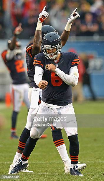 Jay Cutler and Alshon Jeffery of the Chicago Bears celebrate the gamewinning extra point against the Minnesota Vikings at Soldier Field on September...