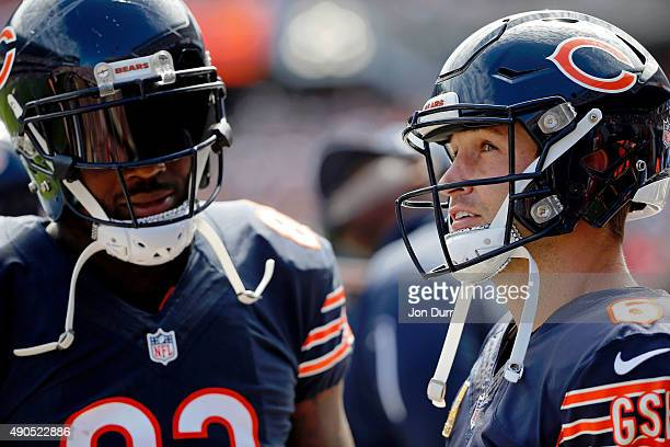 Jay Cutler of the Chicago Bears and Martellus Bennett on the sidelines during the first quarter at Soldier Field on September 20 2015 in Chicago...