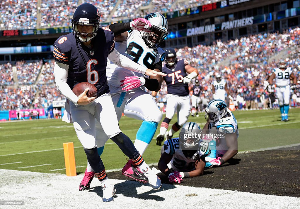 Jay Cutler of the Chicago Bears beats Kawann Short of the Carolina Panthers to the pylon for a touchdown during the first quarter of their game at...