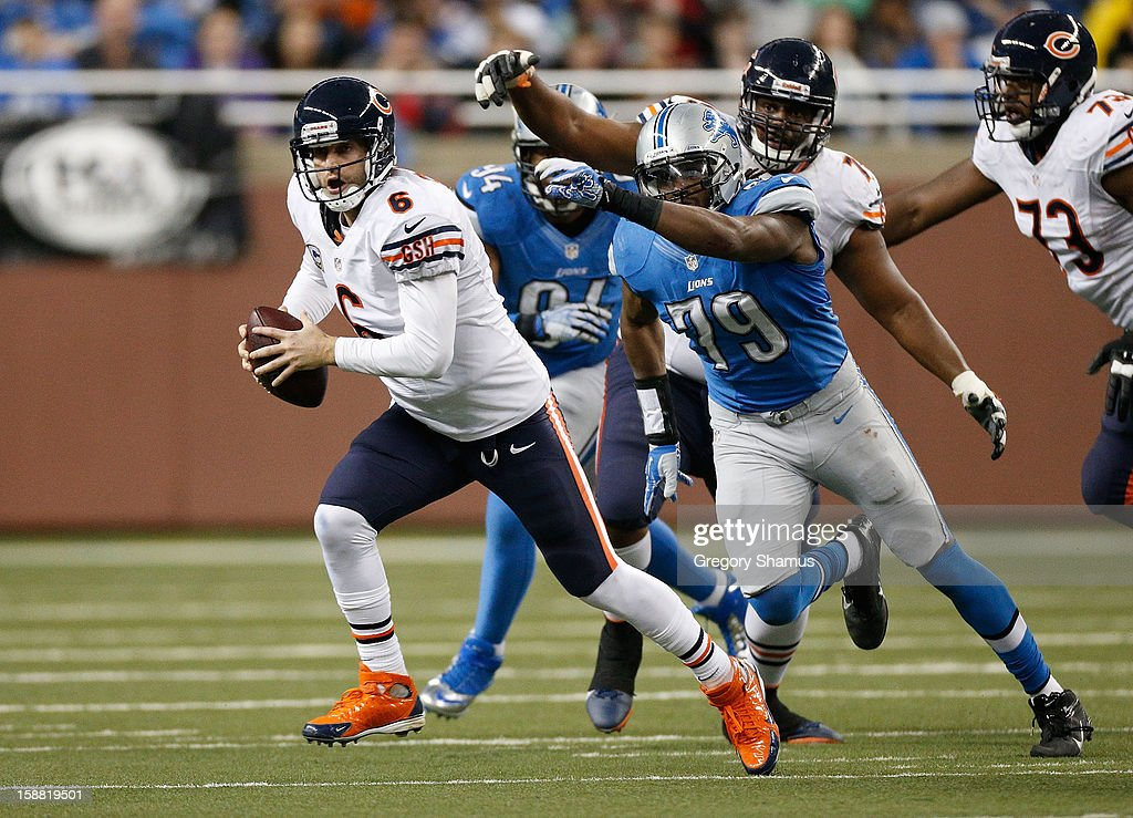 <a gi-track='captionPersonalityLinkClicked' href=/galleries/search?phrase=Jay+Cutler&family=editorial&specificpeople=622249 ng-click='$event.stopPropagation()'>Jay Cutler</a> #6 of the Chicago Bears escapes the rush of Willie Young #79 of the Detroit Lions at Ford Field on December 30, 2012 in Detroit, Michigan. Chicago won the game 26-24.