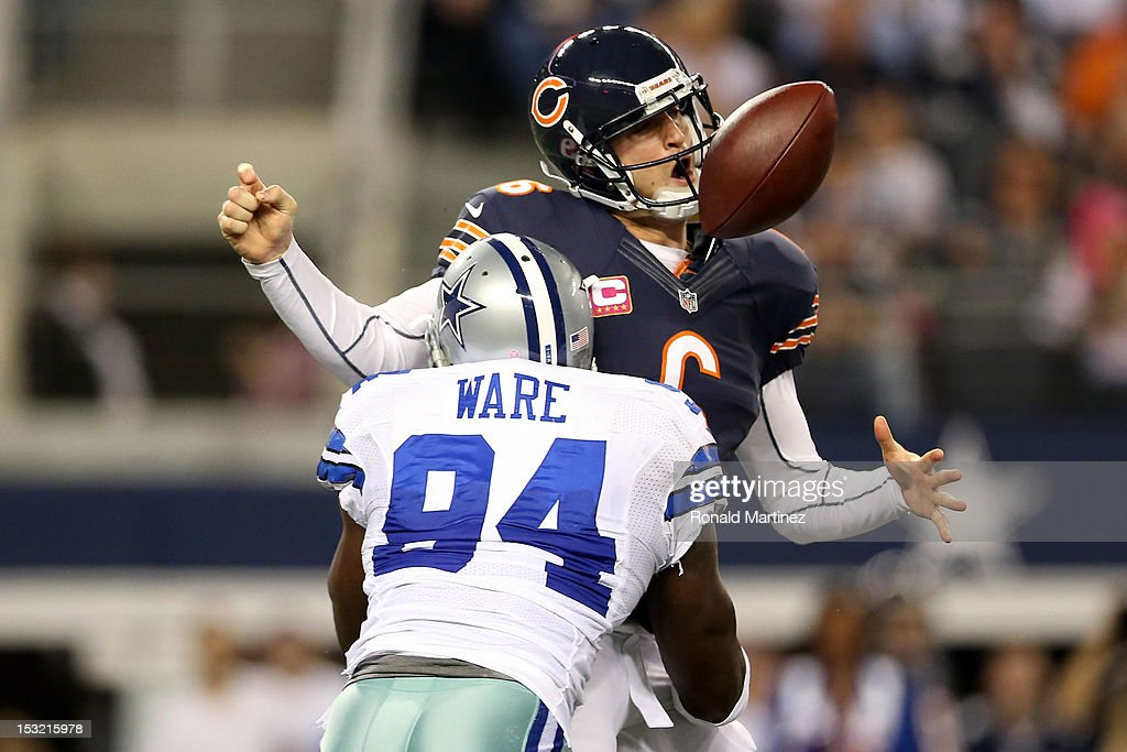 <a gi-track='captionPersonalityLinkClicked' href=/galleries/search?phrase=Jay+Cutler&family=editorial&specificpeople=622249 ng-click='$event.stopPropagation()'>Jay Cutler</a> #6 of the Chicago Bears fumbles the ball as he is sacked by <a gi-track='captionPersonalityLinkClicked' href=/galleries/search?phrase=DeMarcus+Ware&family=editorial&specificpeople=756468 ng-click='$event.stopPropagation()'>DeMarcus Ware</a> #94 of the Dallas Cowboys in the third quarter at Cowboys Stadium on October 1, 2012 in Arlington, Texas.