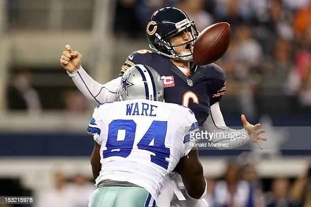 Jay Cutler of the Chicago Bears fumbles the ball as he is sacked by DeMarcus Ware of the Dallas Cowboys in the third quarter at Cowboys Stadium on...