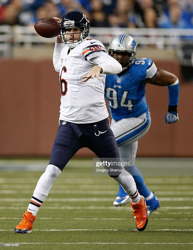 <a gi-track='captionPersonalityLinkClicked' href=/galleries/search?phrase=Jay+Cutler&family=editorial&specificpeople=622249 ng-click='$event.stopPropagation()'>Jay Cutler</a> #6 of the Chicago Bears gets ready to throw a fourth quarter pass in front of Lawrence Jackson #94 of the Detroit Lions at Ford Field on December 30, 2012 in Detroit, Michigan. Chicago won the game 26-24.