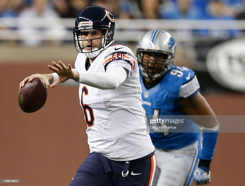 Jay Cutler #6 of the Chicago Bears gets ready to throw a fourth quarter pass in front of Lawrence Jackson #94 of the Detroit Lions at Ford Field on December 30, 2012 in Detroit, Michigan. Chicago won the game 26-24.