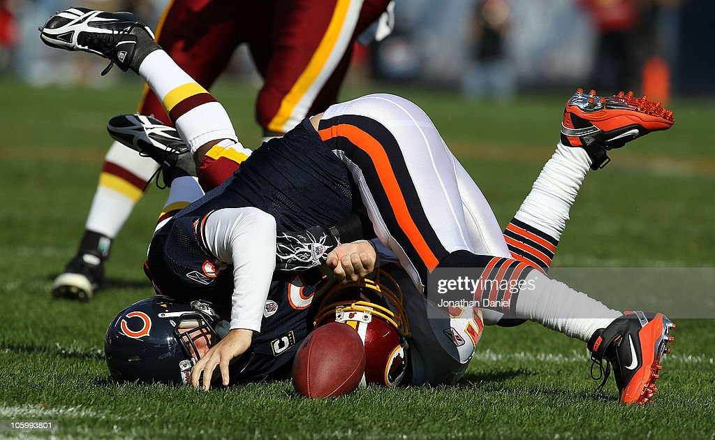 Jay Cutler of the Chicago Bears hits the ground after being sacked by Rocky McIntosh of the Washington Redskins at Soldier Field on October 24 2010...