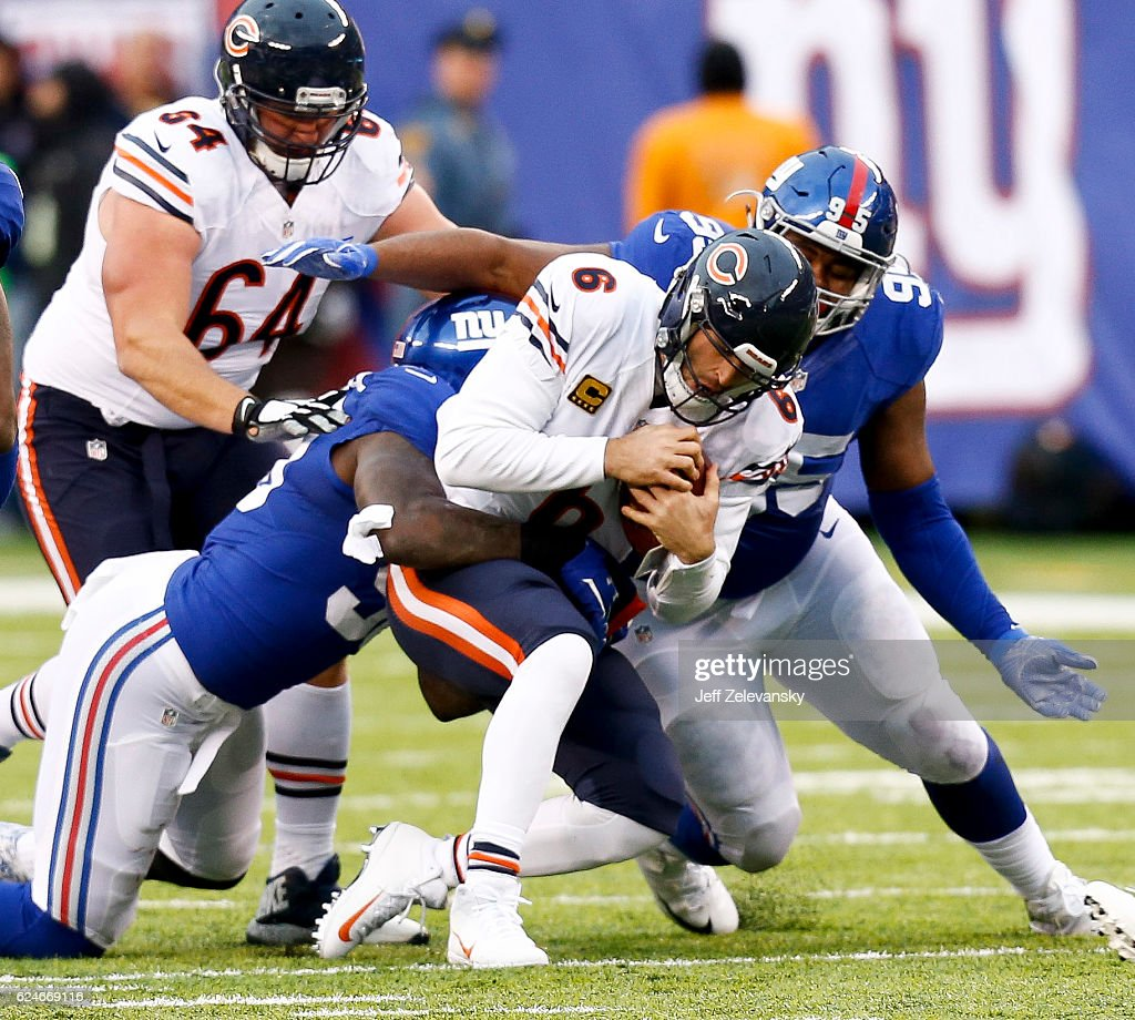Jay Cutler #6 of the Chicago Bears is sacked by Jason Pierre-Paul #90 and Johnathan Hankins #95 of the New York Giants during their game at MetLife Stadium on November 20, 2016 in East Rutherford, New Jersey.