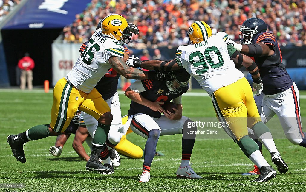 Jay Cutler #6 of the Chicago Bears is sacked by Julius Peppers #56 and B.J. Raji #90 of the Green Bay Packers at Soldier Field on September 13, 2015 in Chicago, Illinois. The Packers defeated the Bears 31-23.