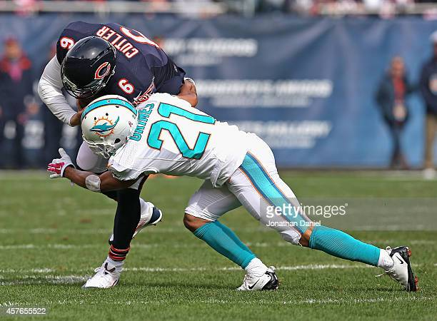 Jay Cutler of the Chicago Bears is tackled by Brent Grimes of the Miami Dolphins at Soldier Field on October 19 2014 in Chicago Illinois The Dolphins...