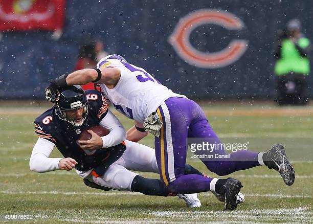 Jay Cutler of the Chicago Bears is tackled by Chad Greenway of the Minnesota Vikings during the second quarter of a game at Soldier Field on November...
