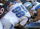 Jay Cutler of the Chicago Bears is taken down by Nick Fairley of the Detroit Lions at Soldier Field on November 10 2013 in Chicago Illinois The Lions...